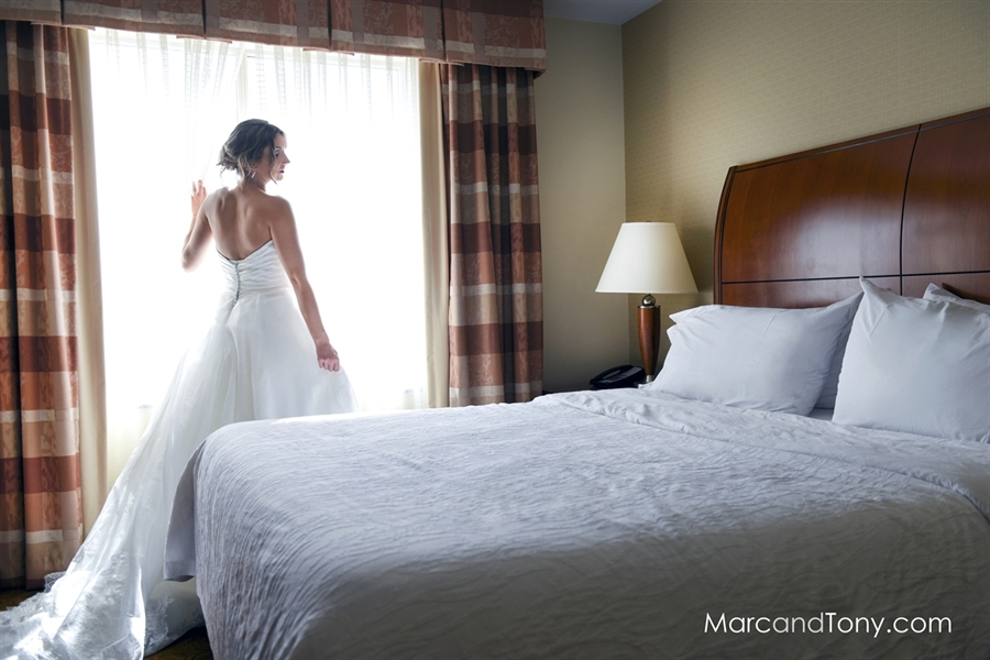 Bride by Her Bridal Suite's Window